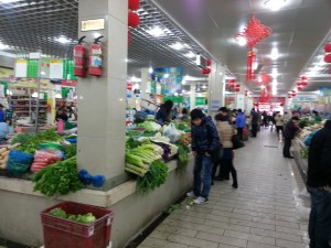 My local grocer now: vegetables, meat, eggs, tofu, all in an open market.
